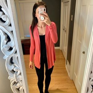 Pink cardigan with lace in the back.